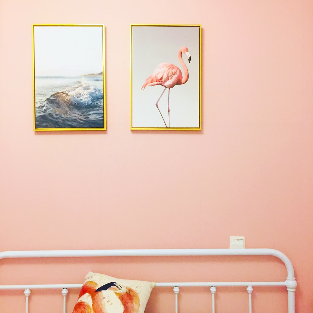 flamingo illustration with brown frame on wall