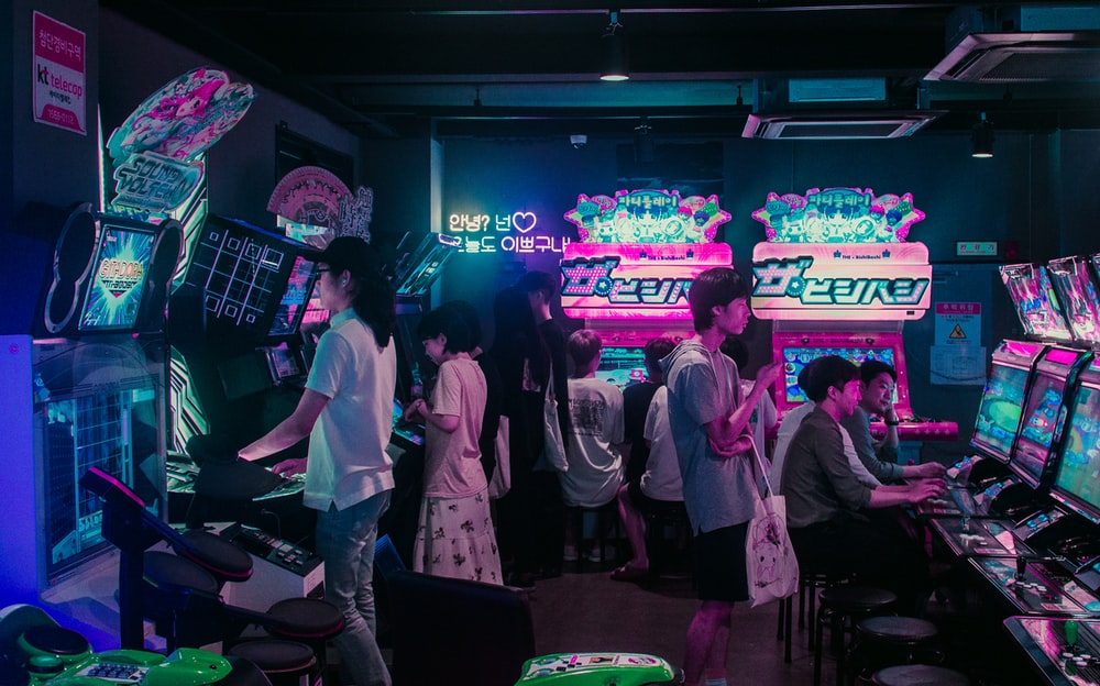 people playing arcade games