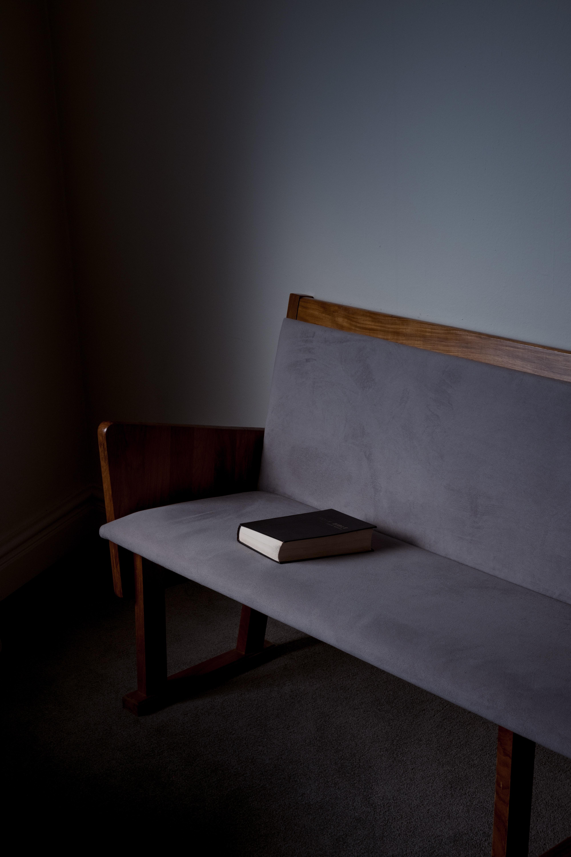 black book on gray sofa