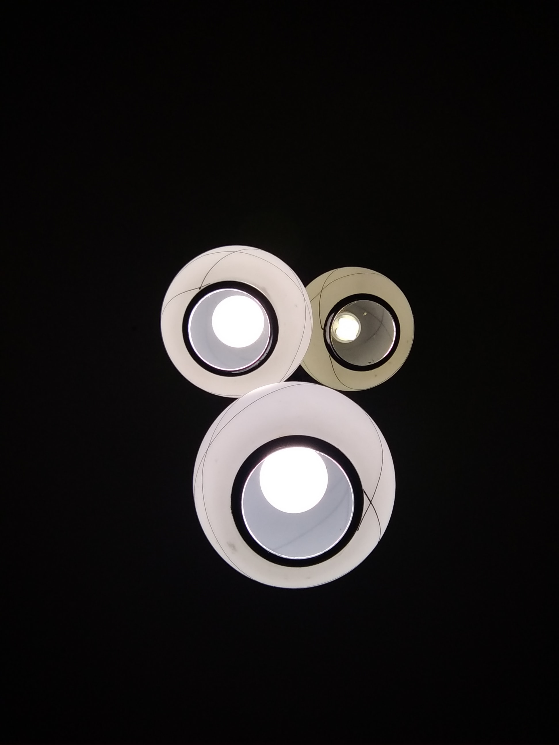 three white pendant lamps
