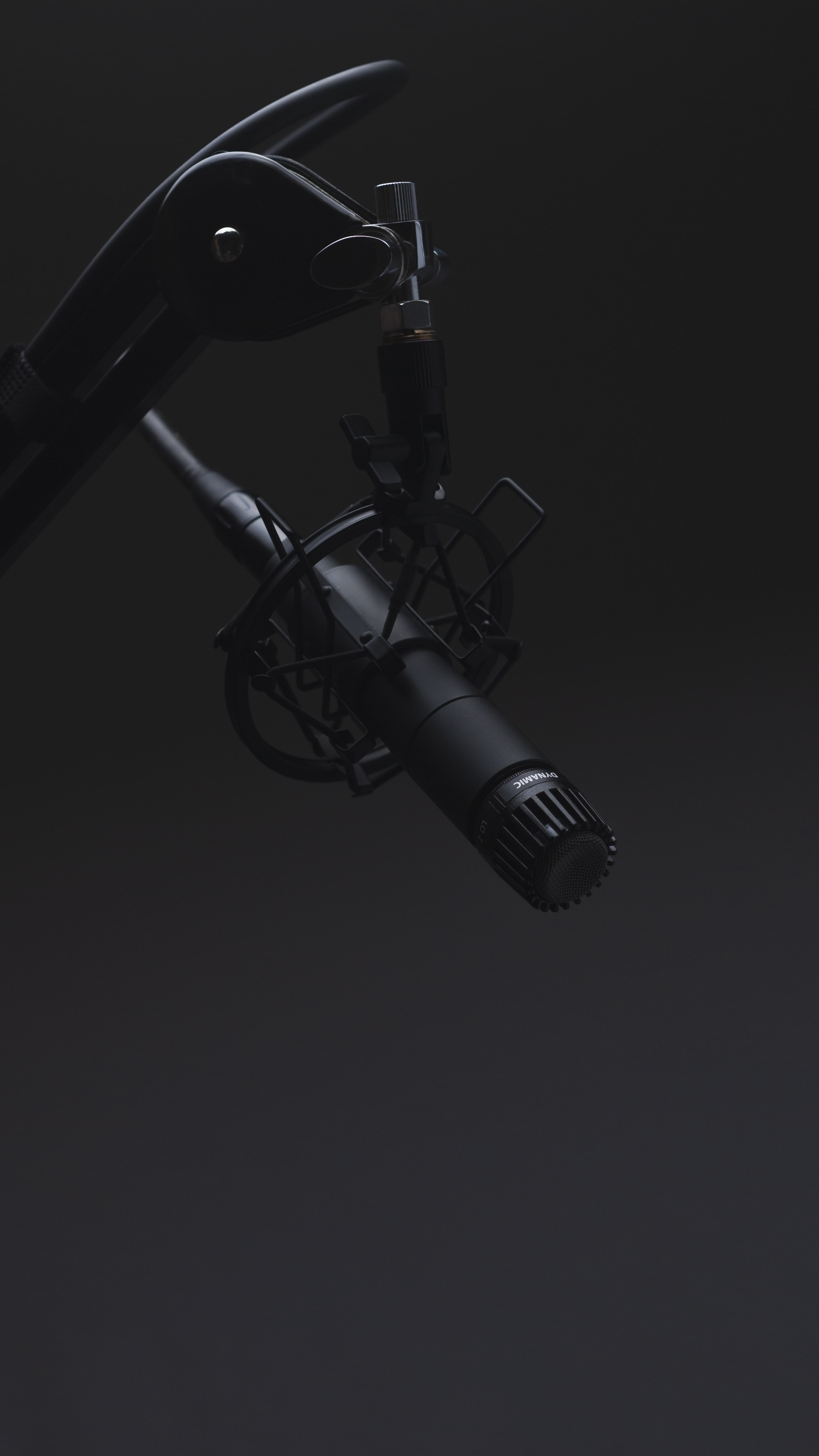 black microphone in dimmed room