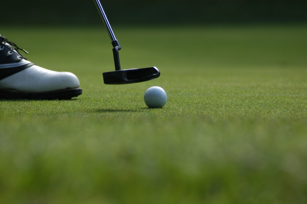 Six Golf Balls Near Hole And One Golf Club Photo Free Sport Image On Unsplash