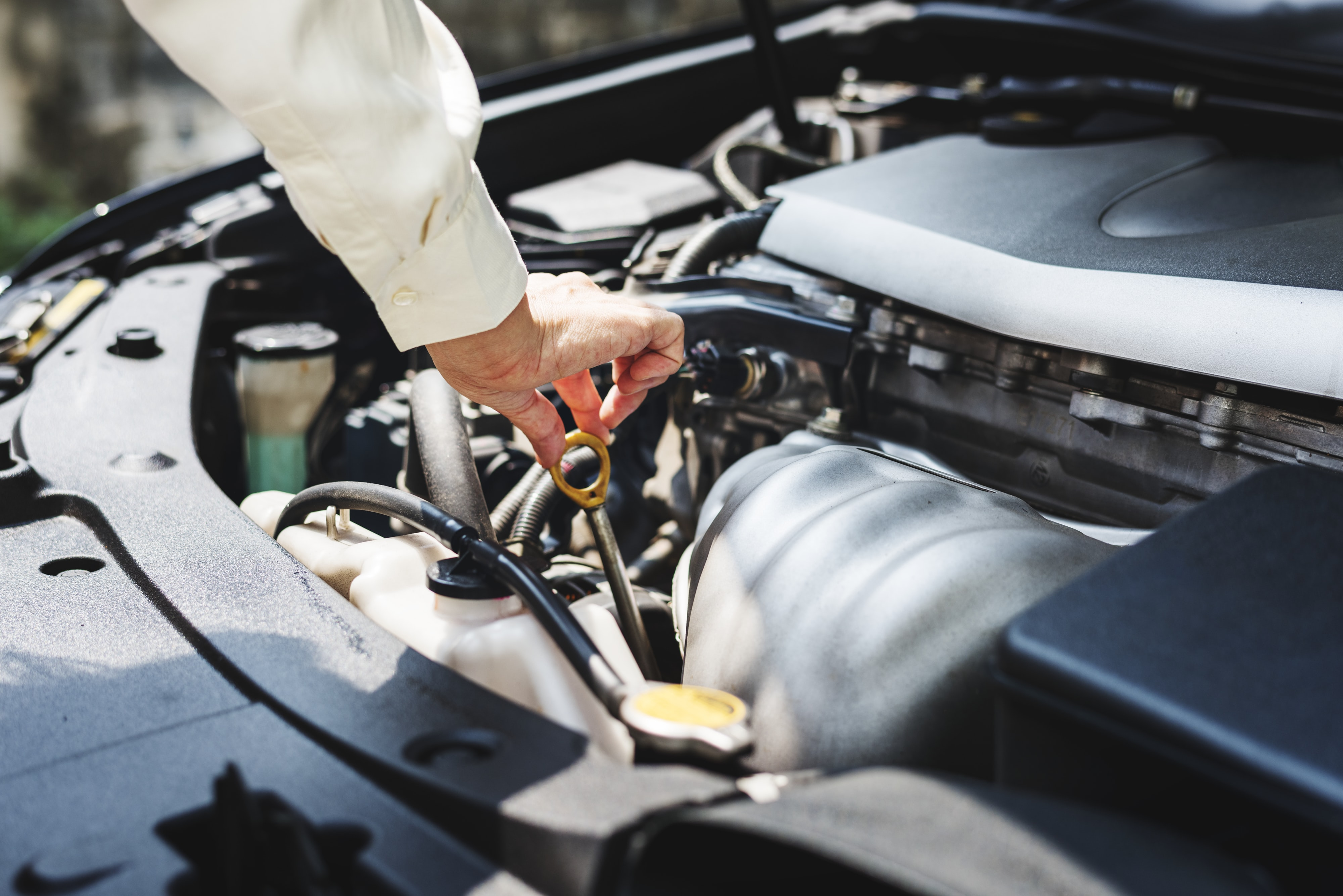 person holding round brown vehicle engine part