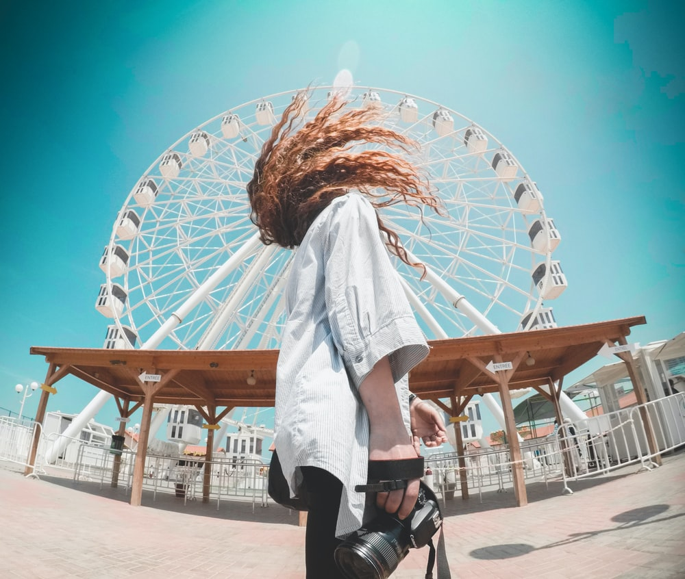 person standing in front of ferris wheel