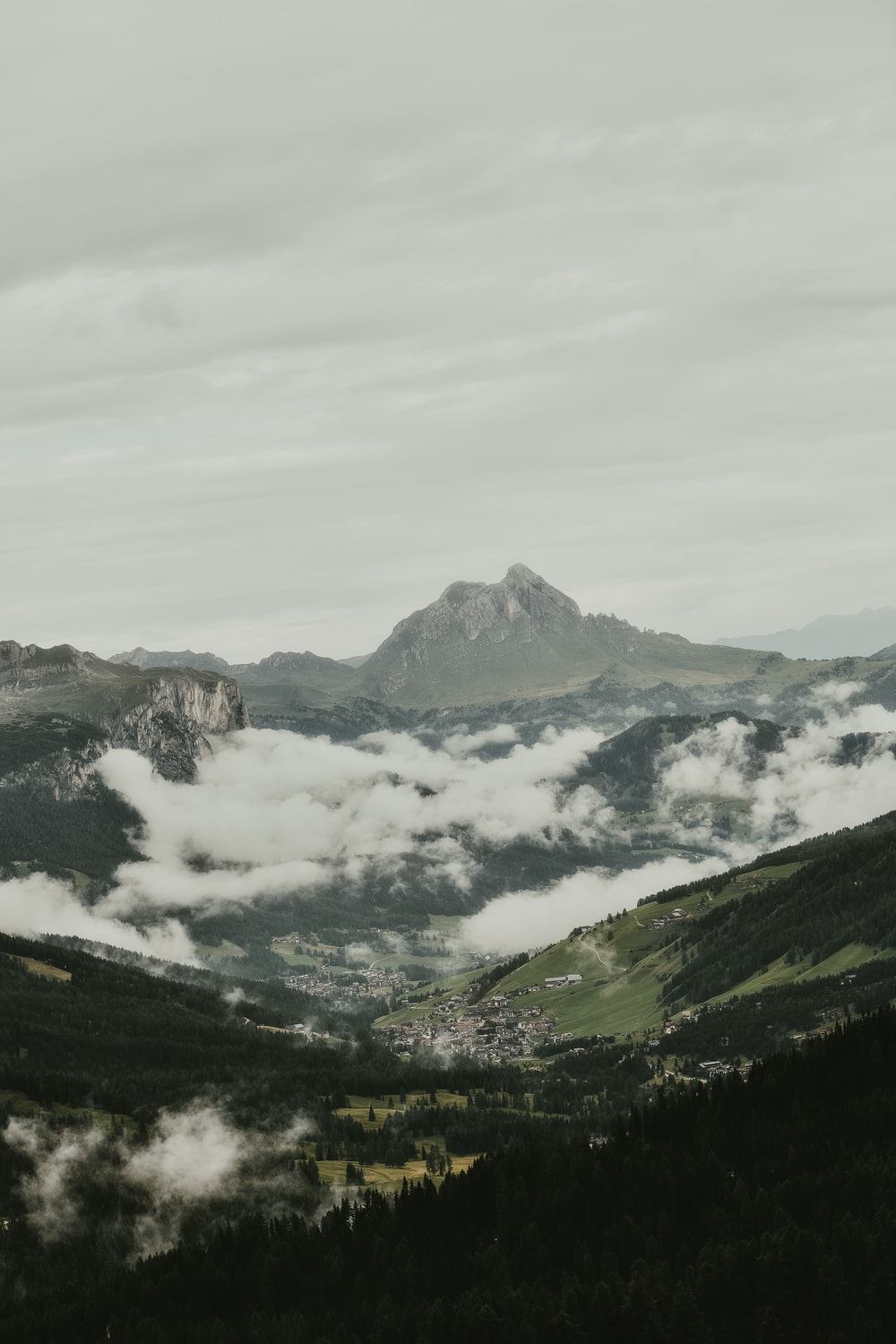 aerial photography of mountains surrounded by clouds