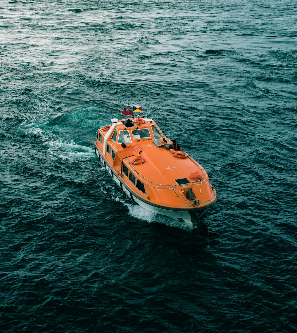 aerial photography of orange power boat