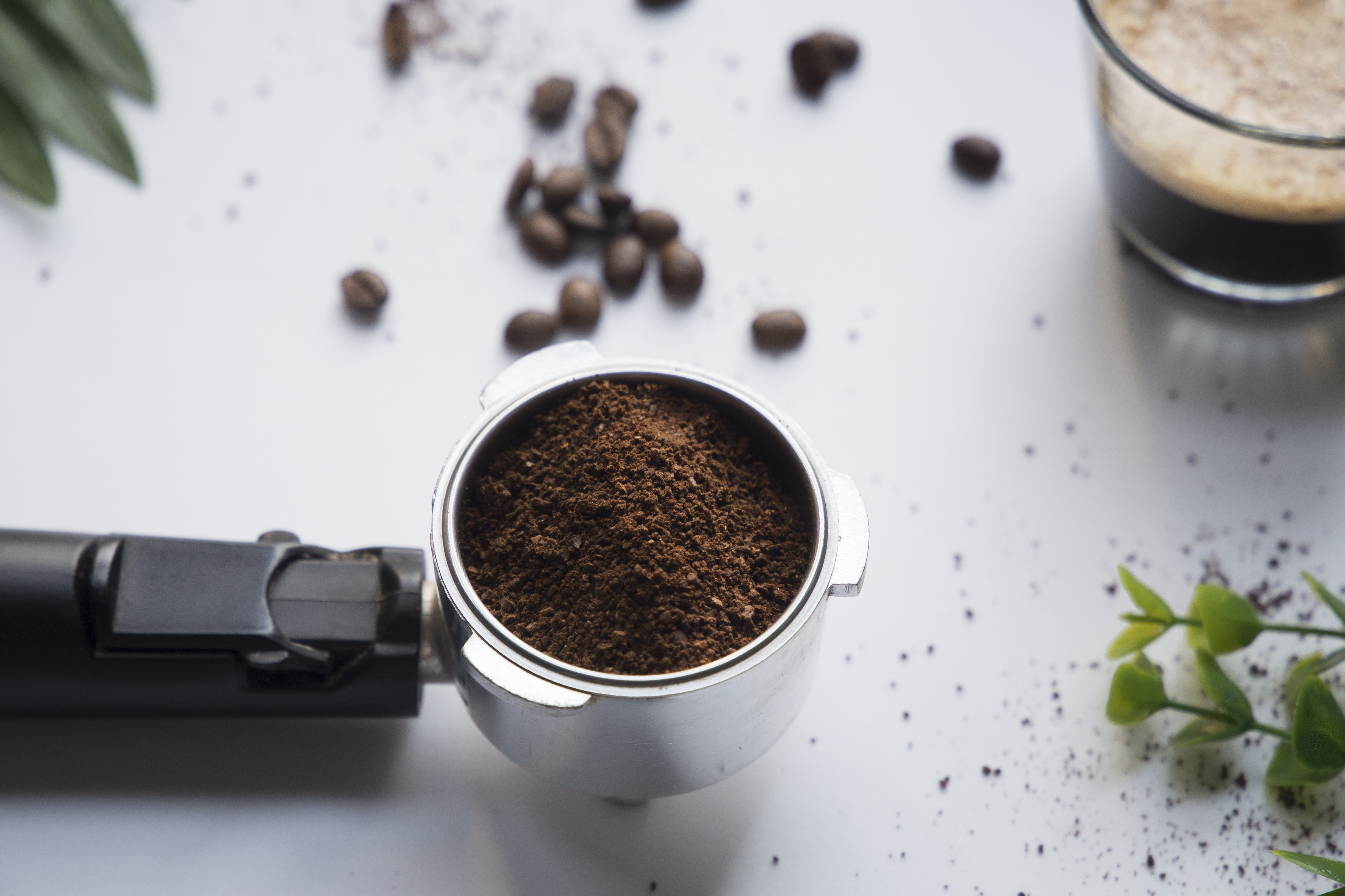 grained coffee in gray stainless steel container