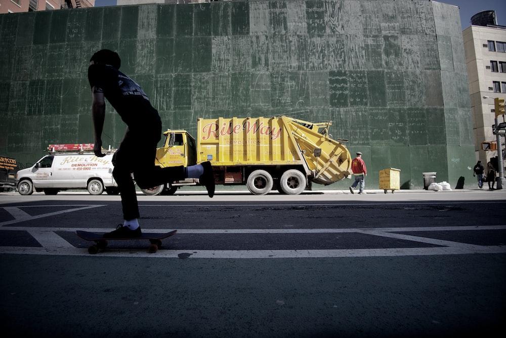 yellow dump truck in street