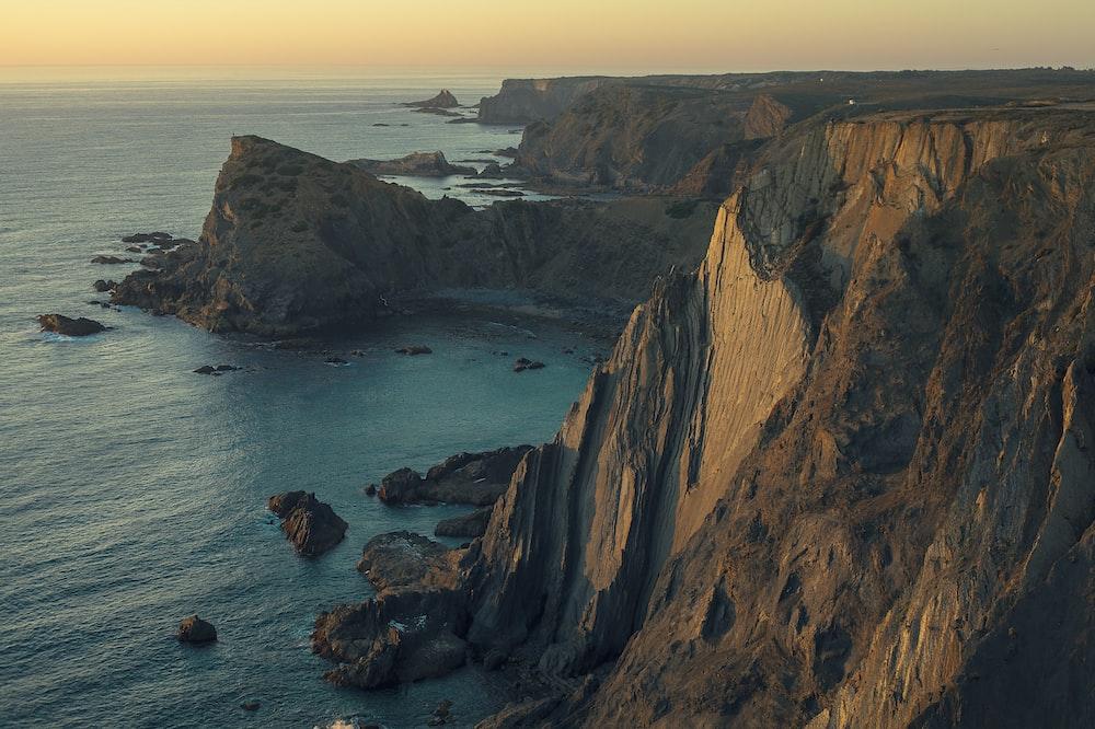 aerial photography of mountain near sea
