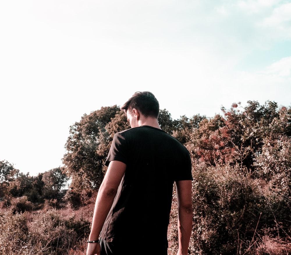 man walking near trees