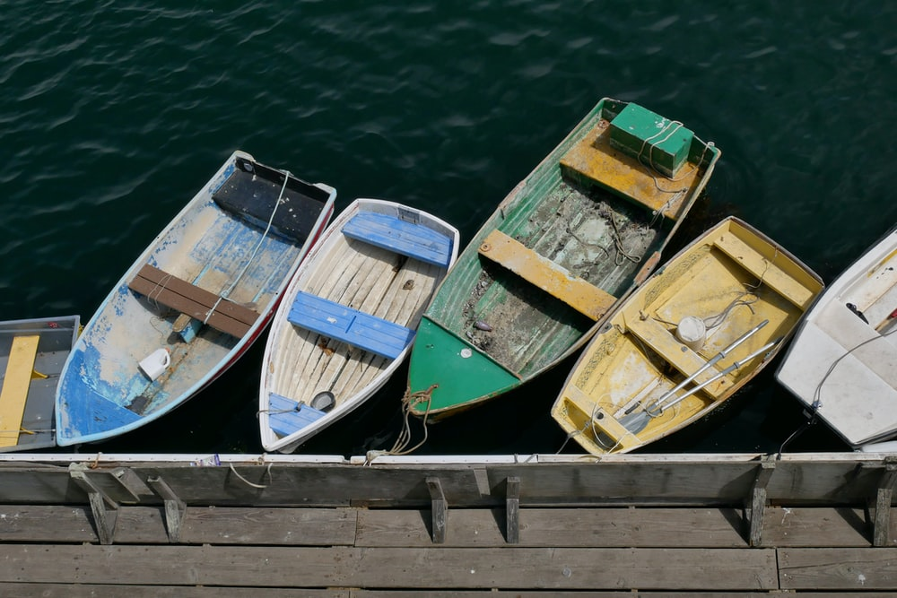 five parked motor boats