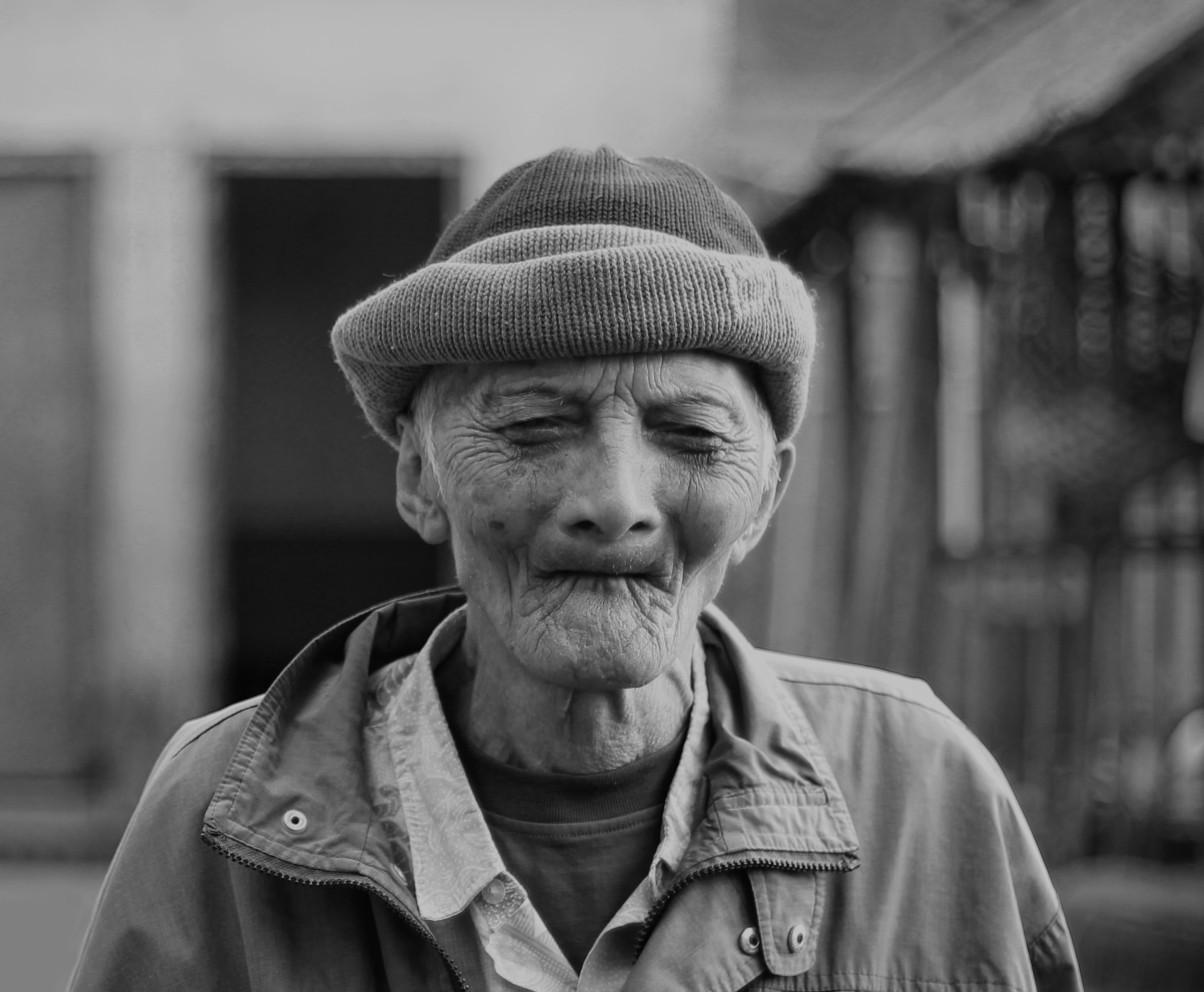 grayscale photography of man closing his eyes while taking him a picture
