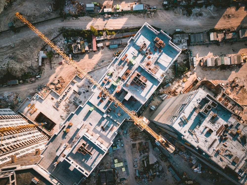 aerial view photography of vehicles and buildings during daytime