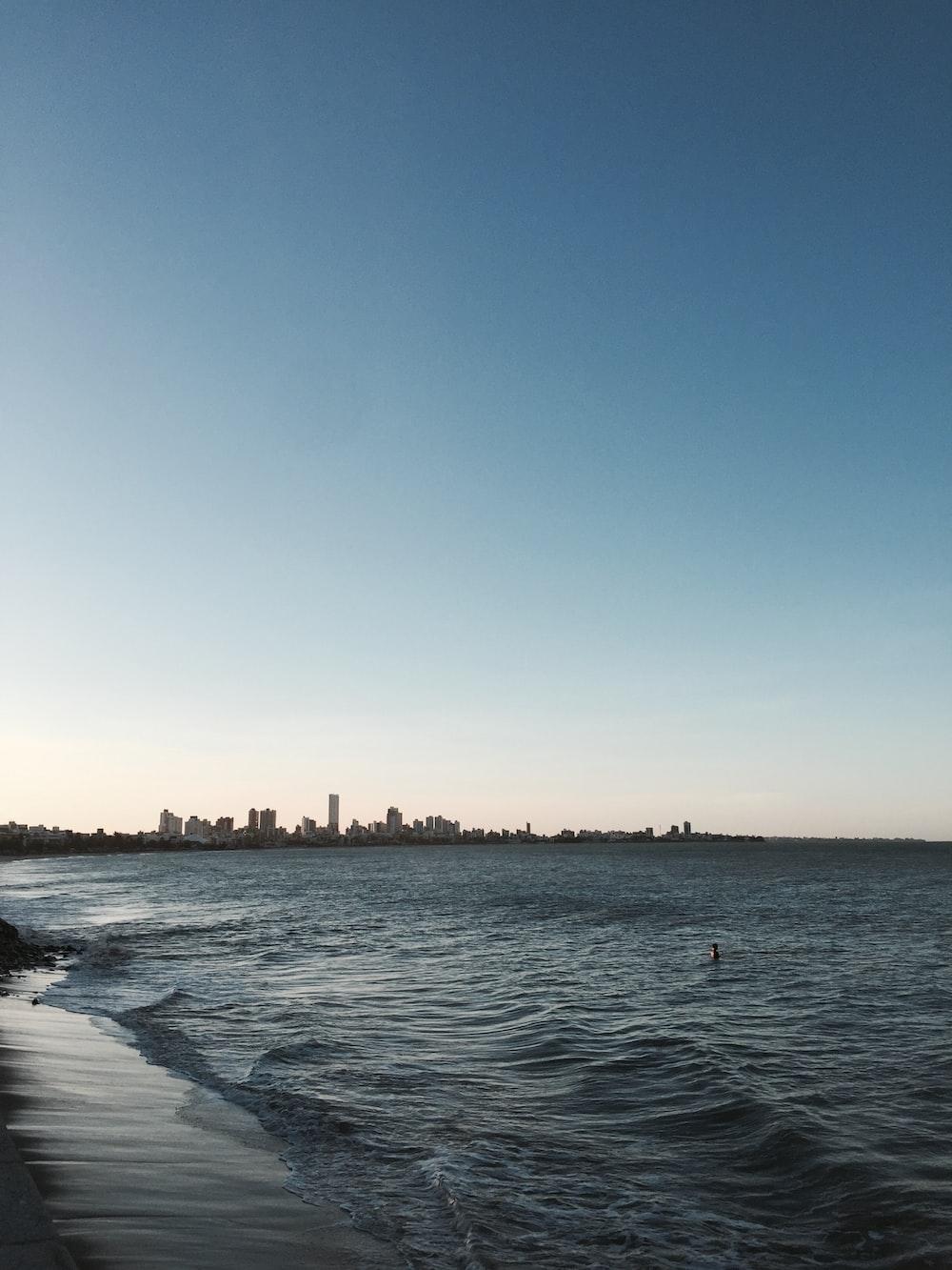 seawave under blue sky during daytime