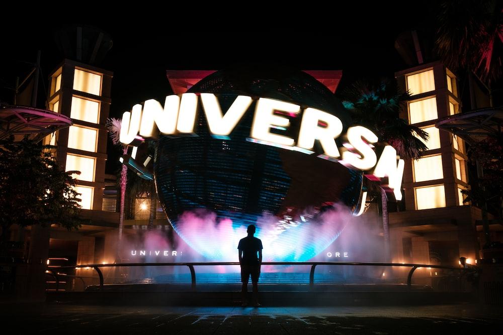 man standing in front of Universal Studio