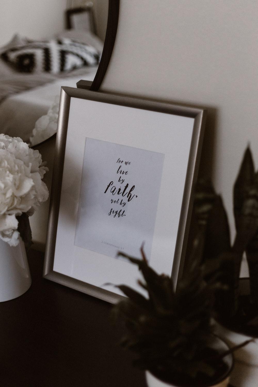 photo frame beside flowers