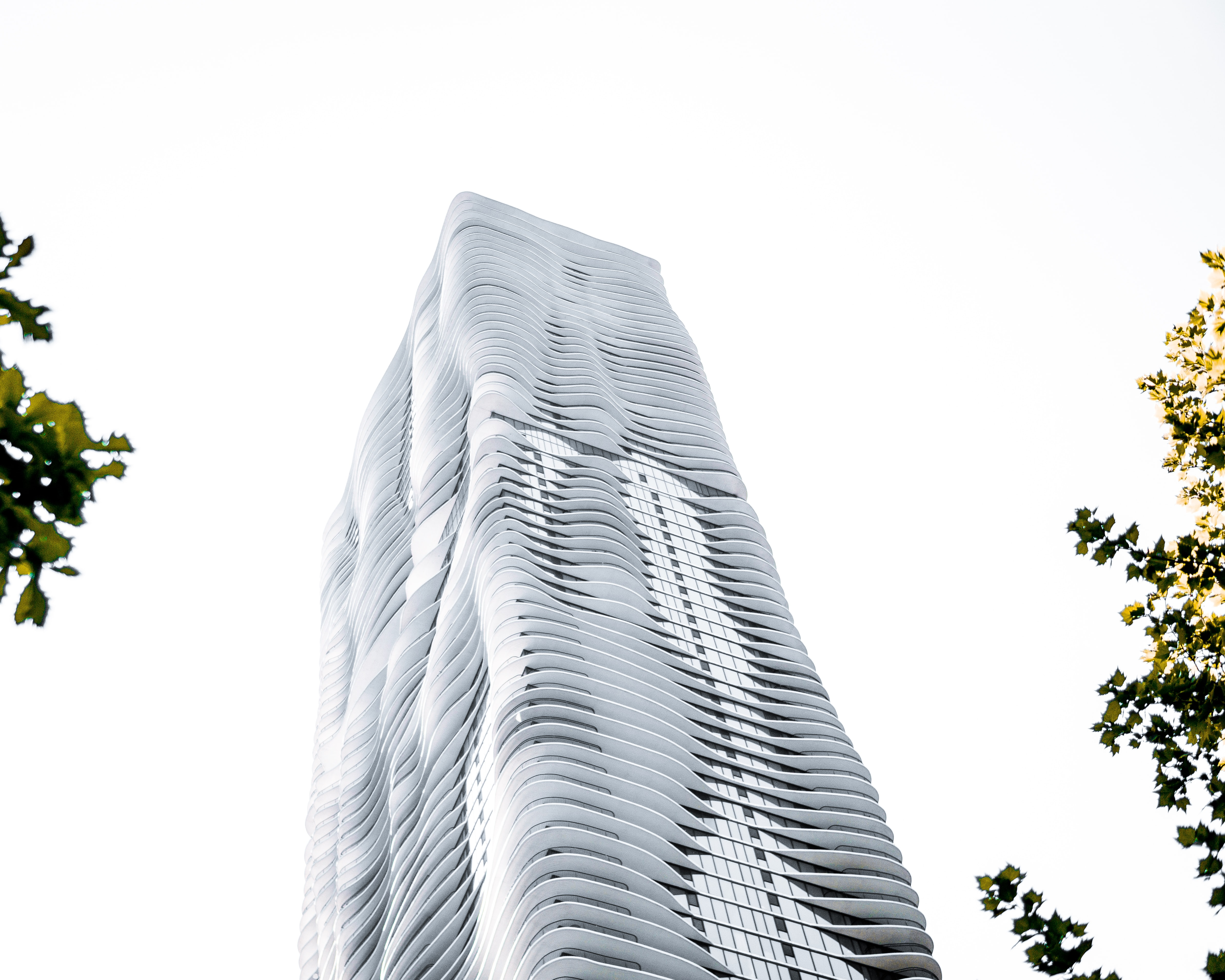 low angle photography of curtain building during daytime