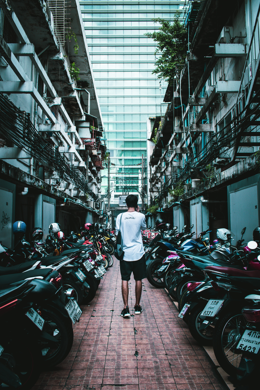 man walking in between motorcycles
