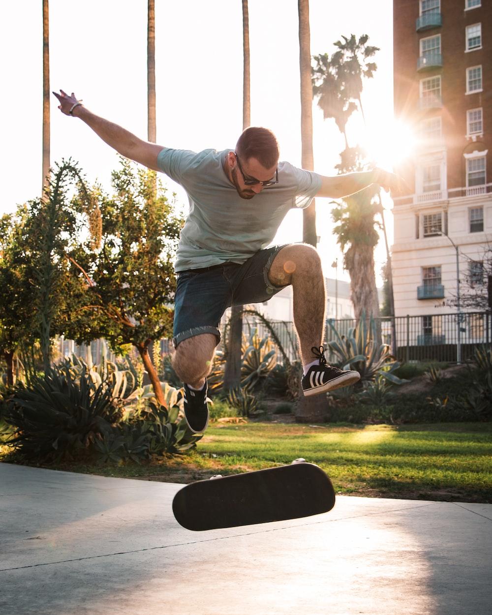 man doing skateboard exhibition at daytime