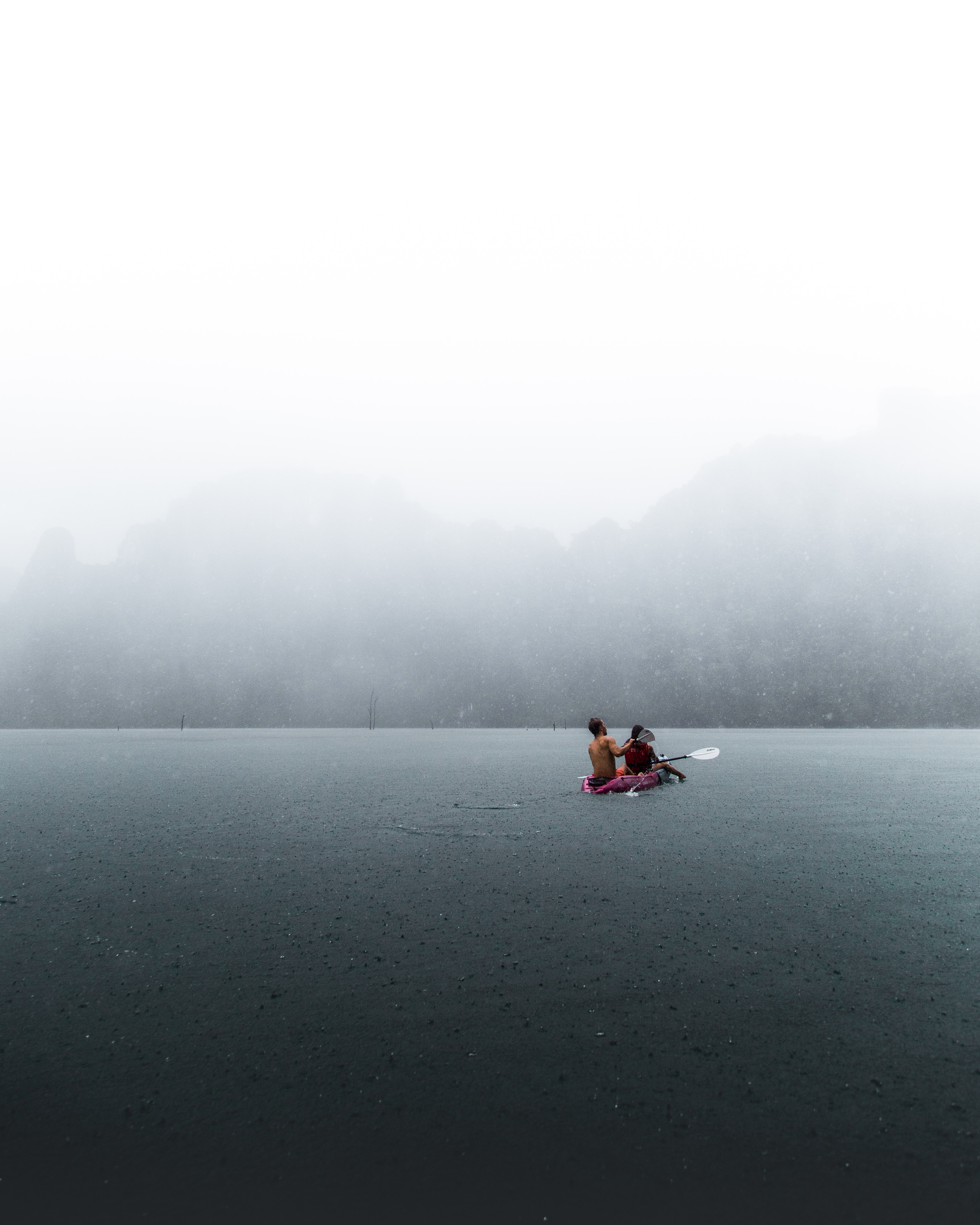 person in boat on body of water