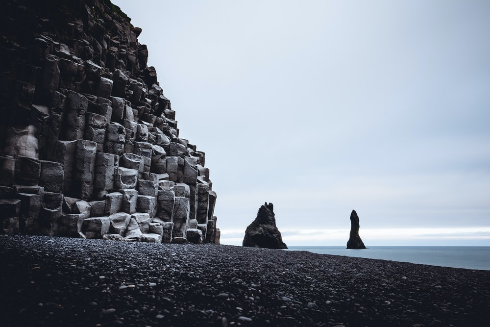 body of water near rocks