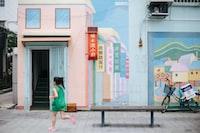 girl running beside bench