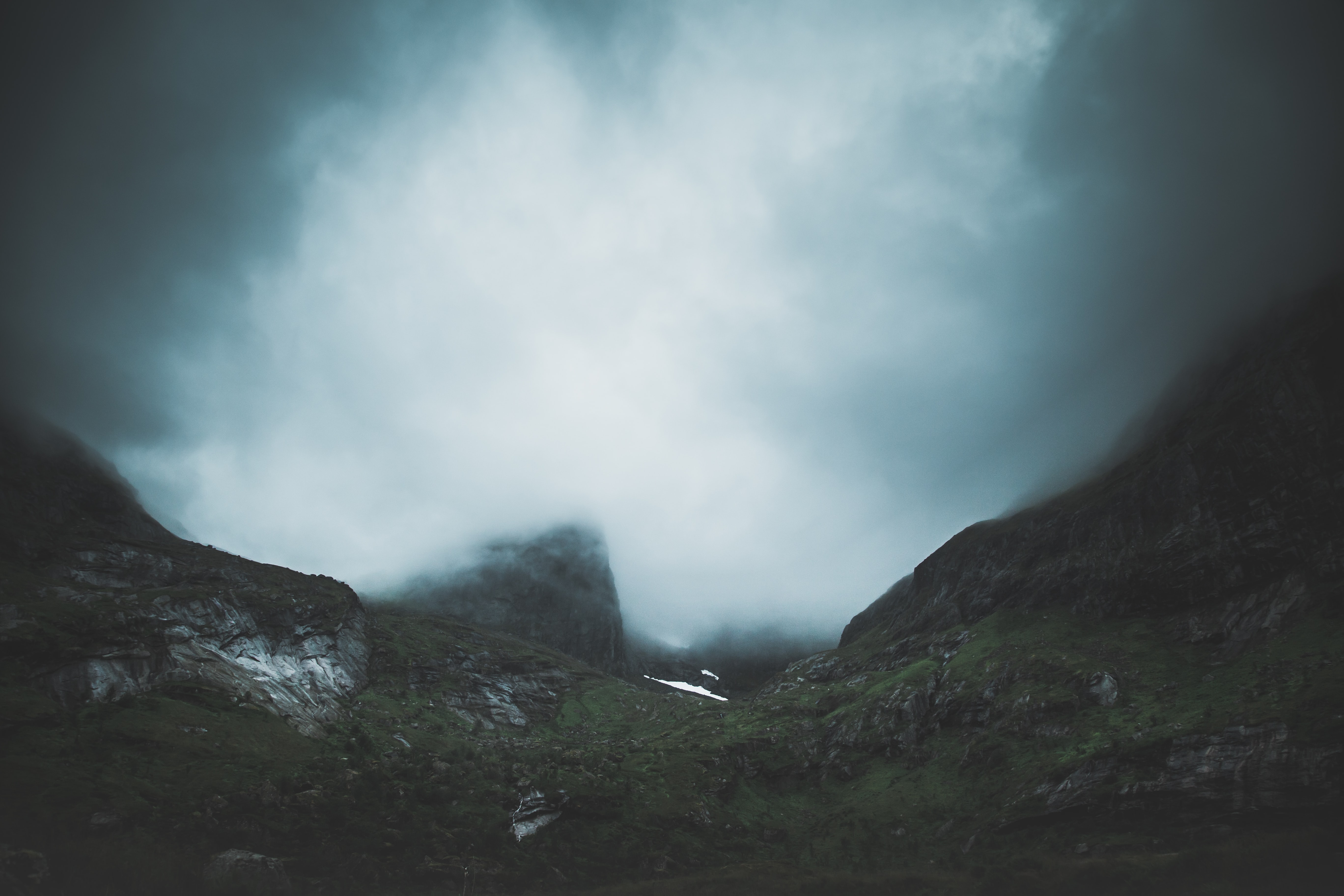 photography of foggy mountain