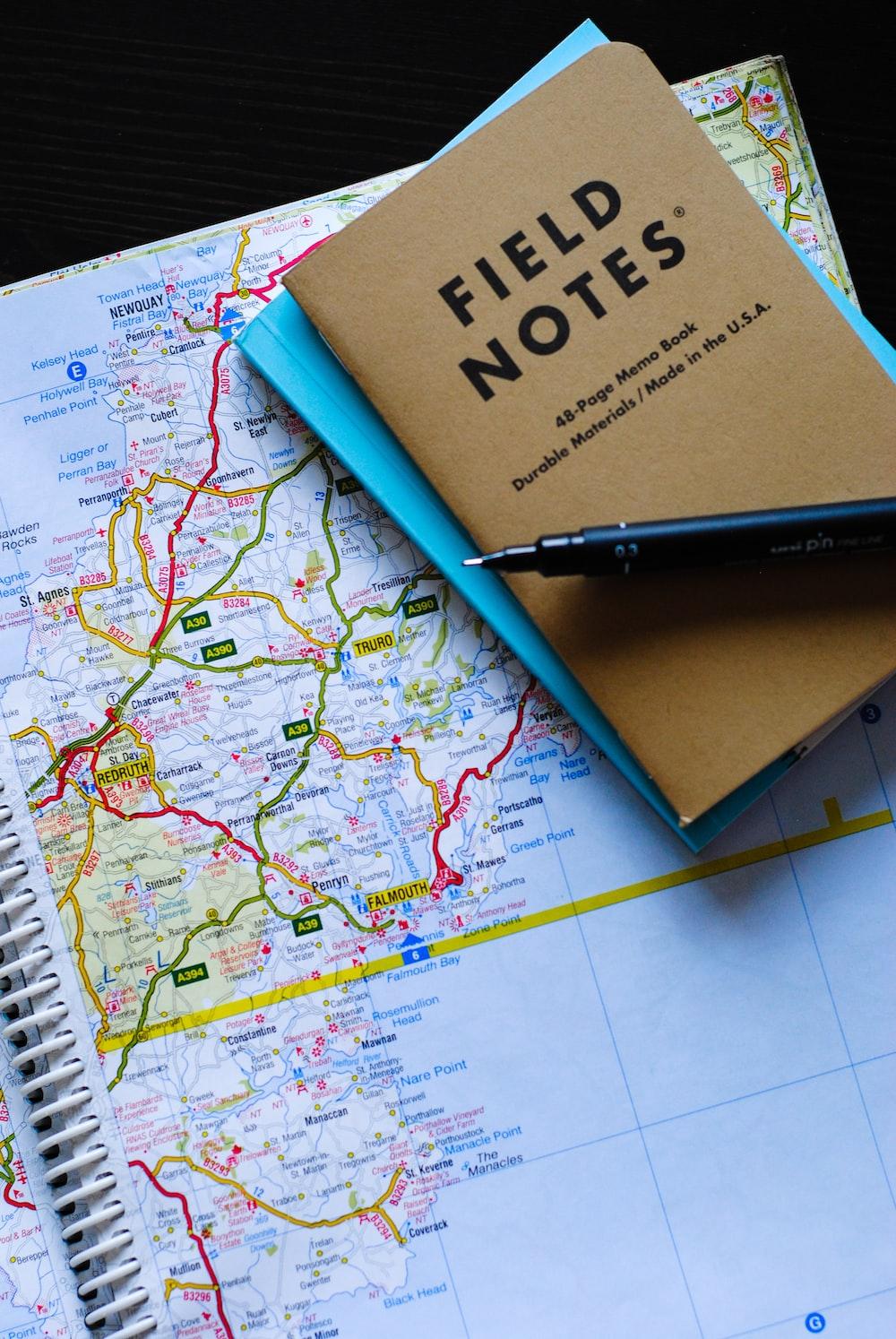 black gel pen on Field Notes book