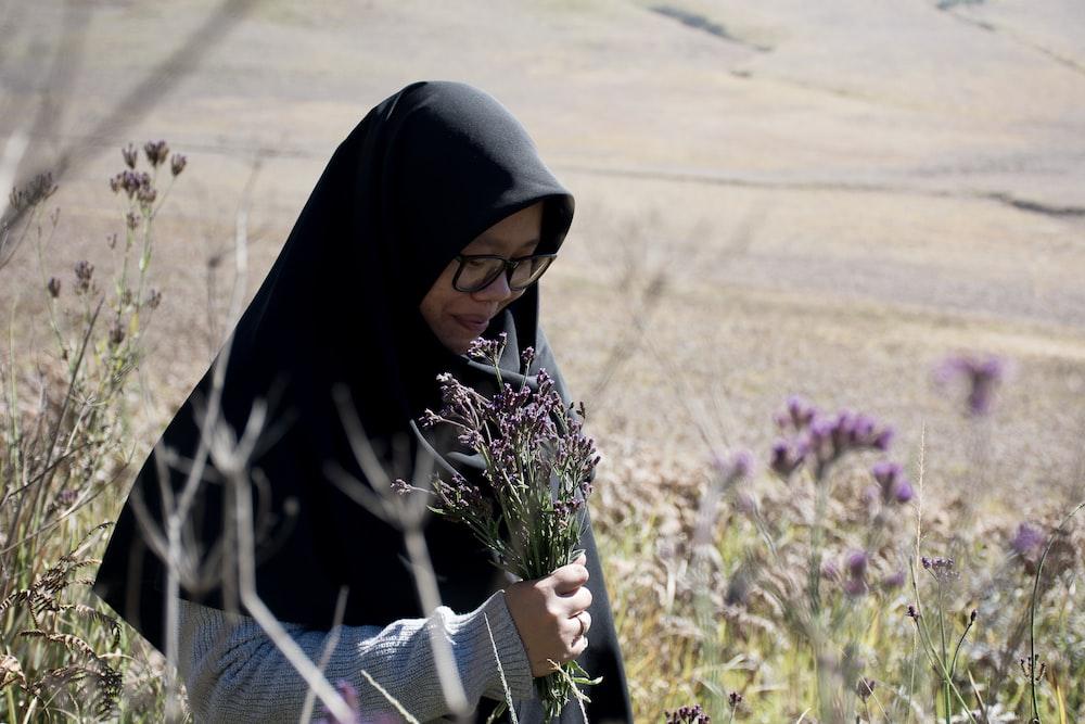 woman in black hijab headdress