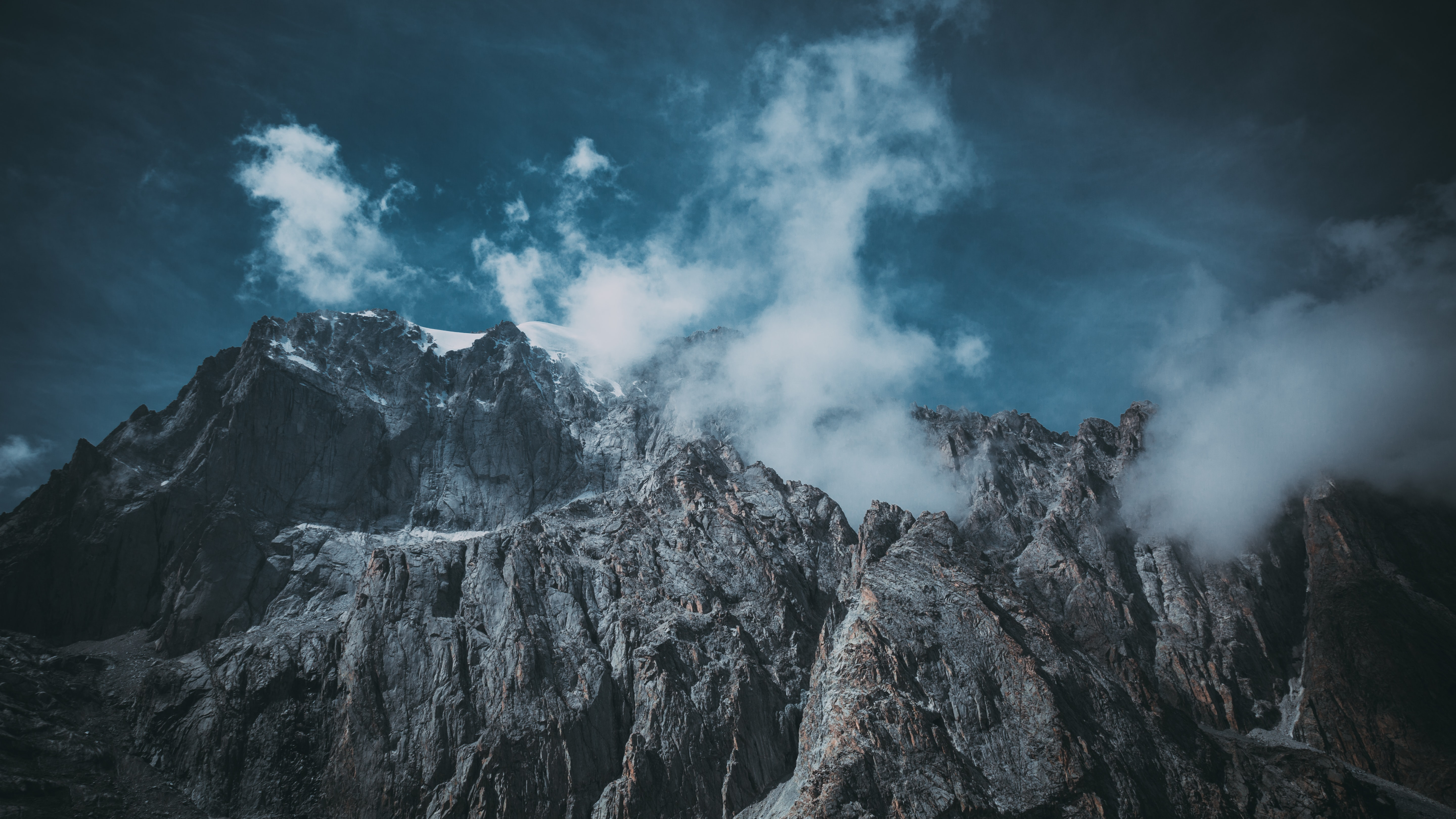 landscape photography of cliff and mountains