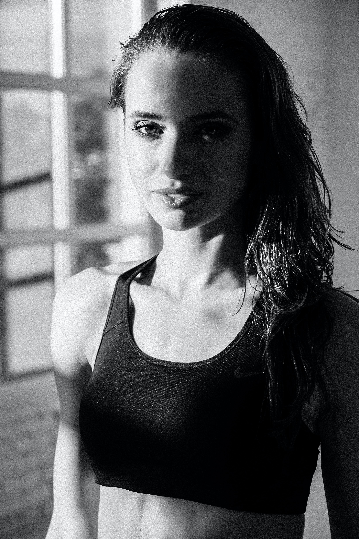 grayscale photography of woman wearing sports bra