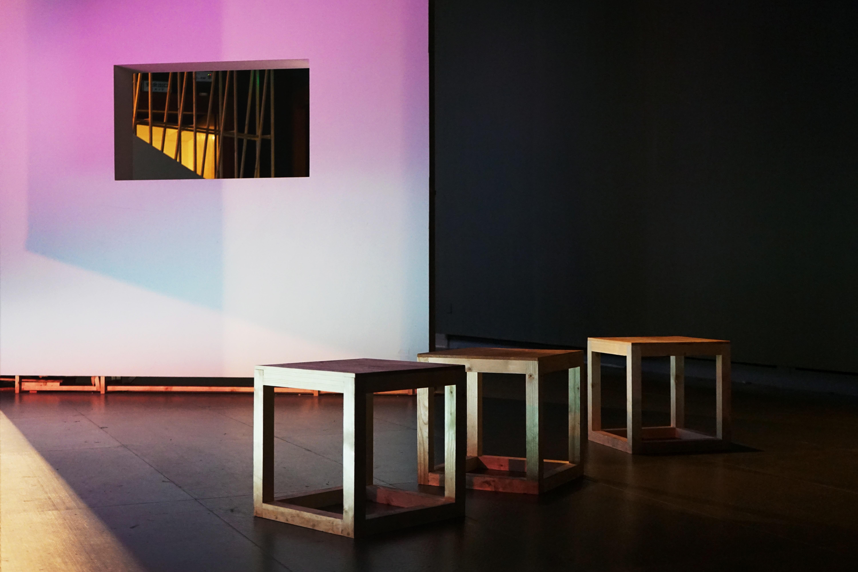 several chairs near white wall