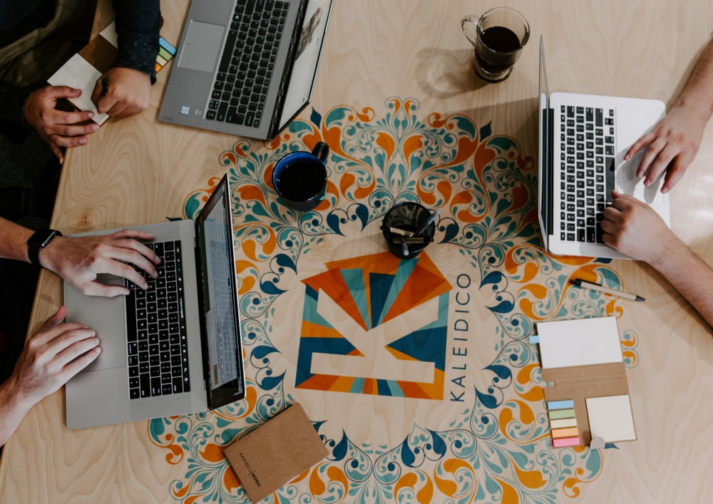three person using laptops