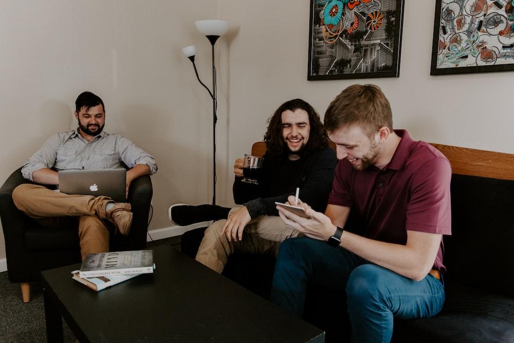 men sitting on sofa
