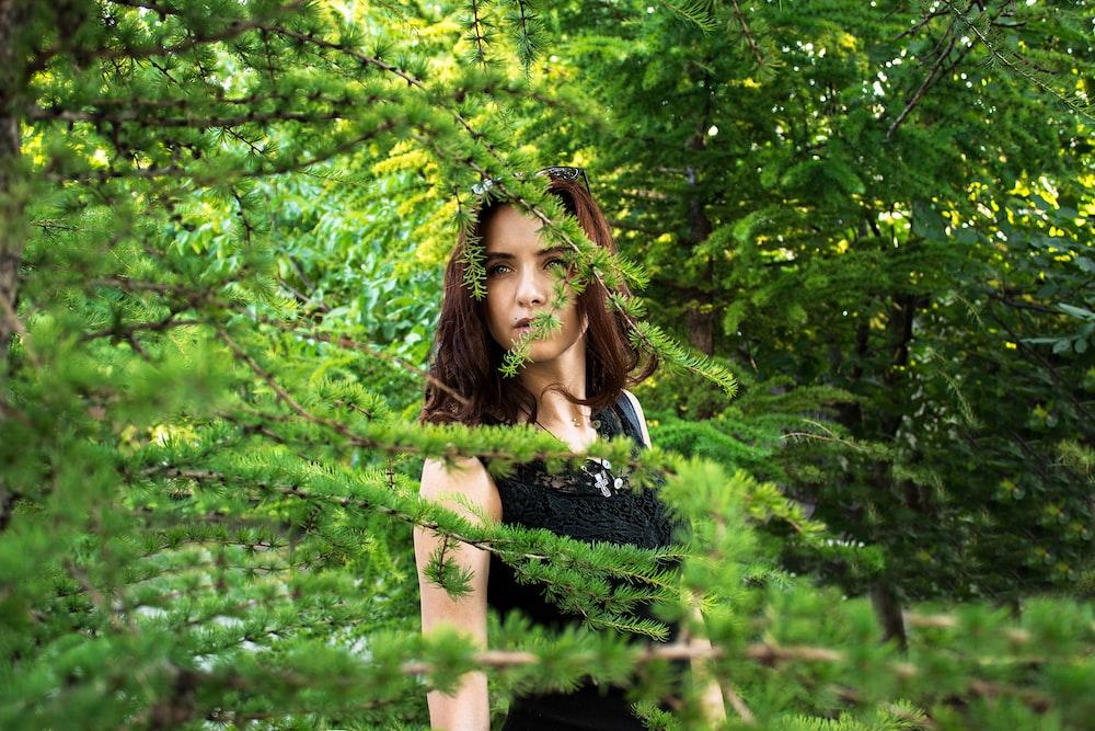 woman beside green tree
