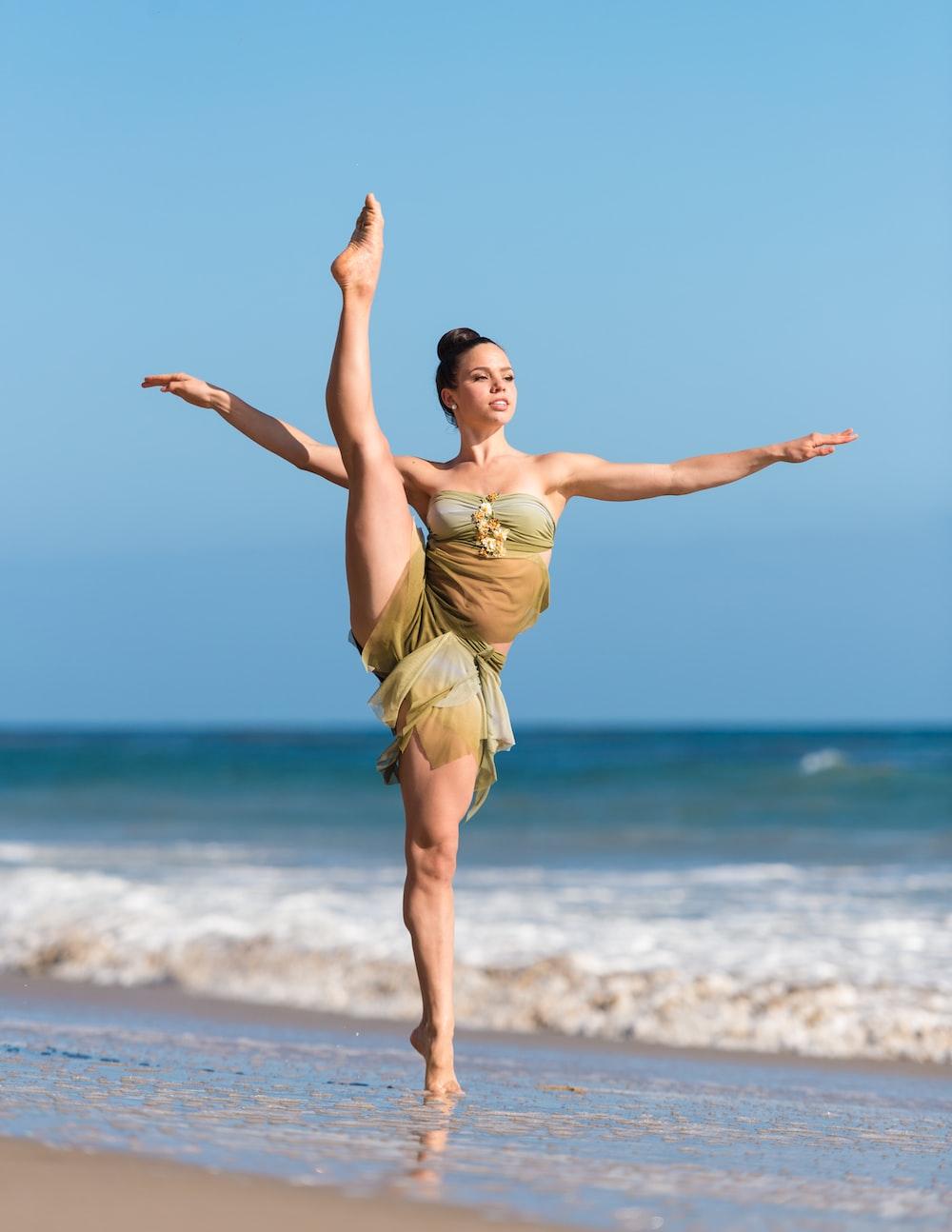 woman dancing in seashore