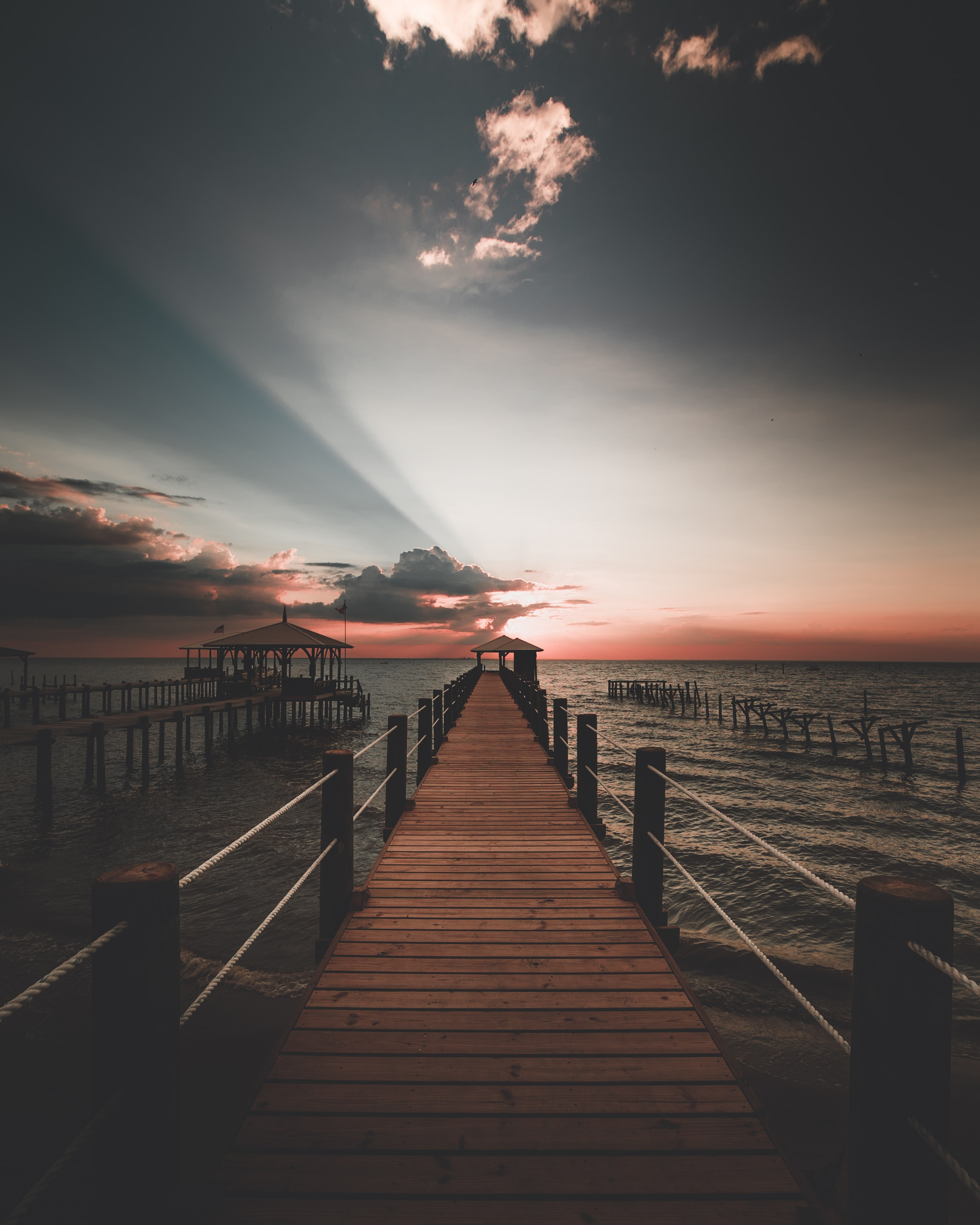 photography of dock during sunset