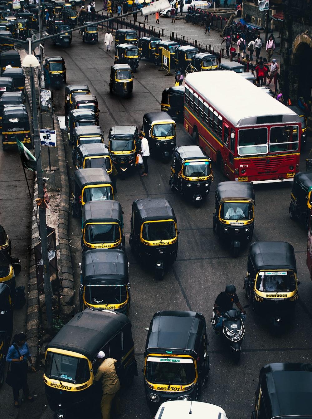 black-and-yellow auto rickshaw on road