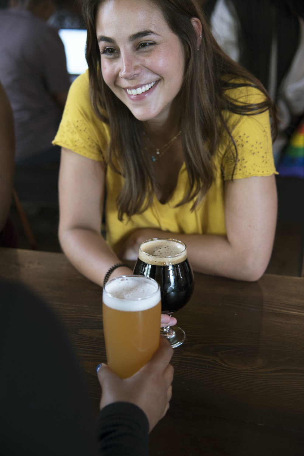 smiling woman in front of table