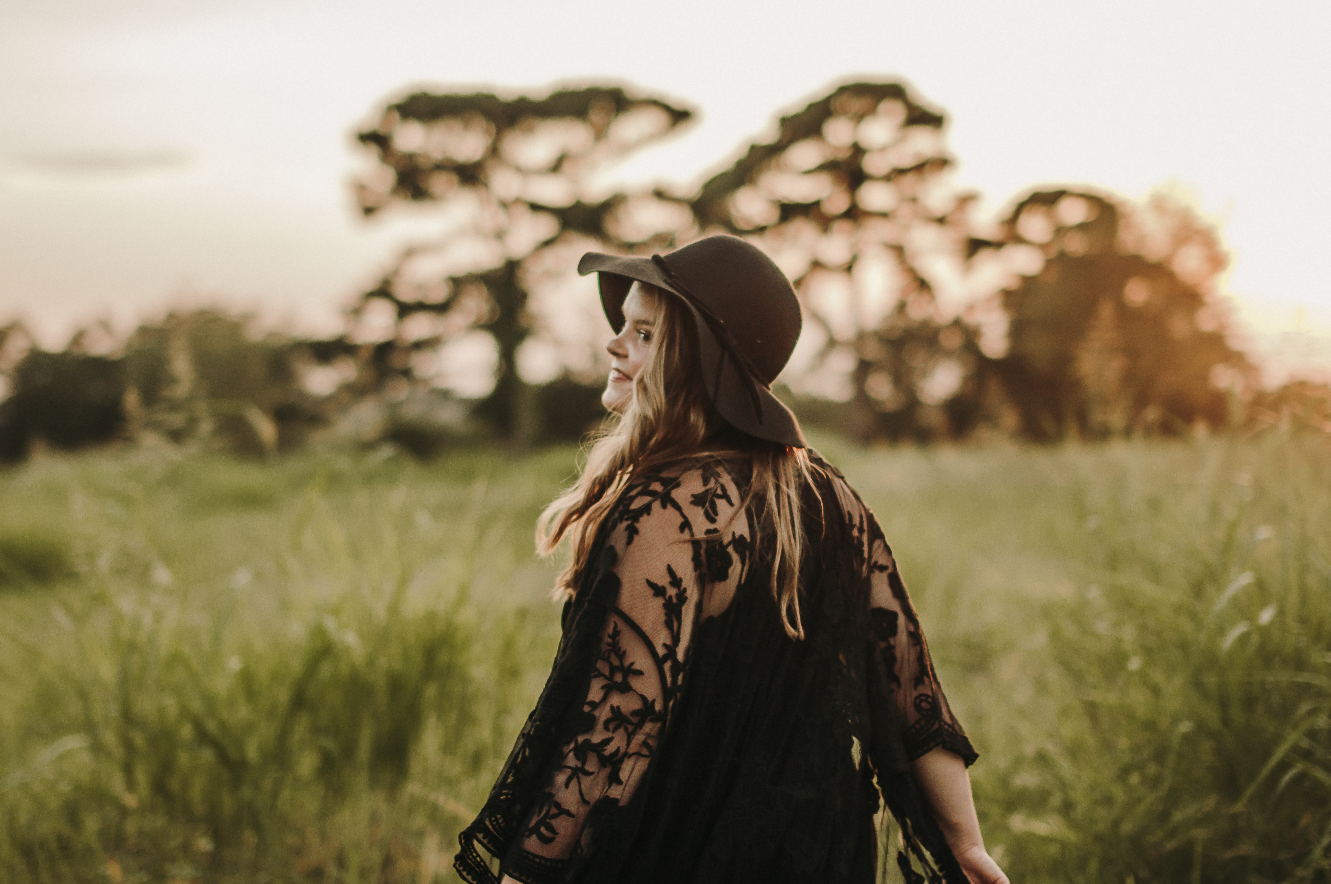 shallow focus of woman on grasses