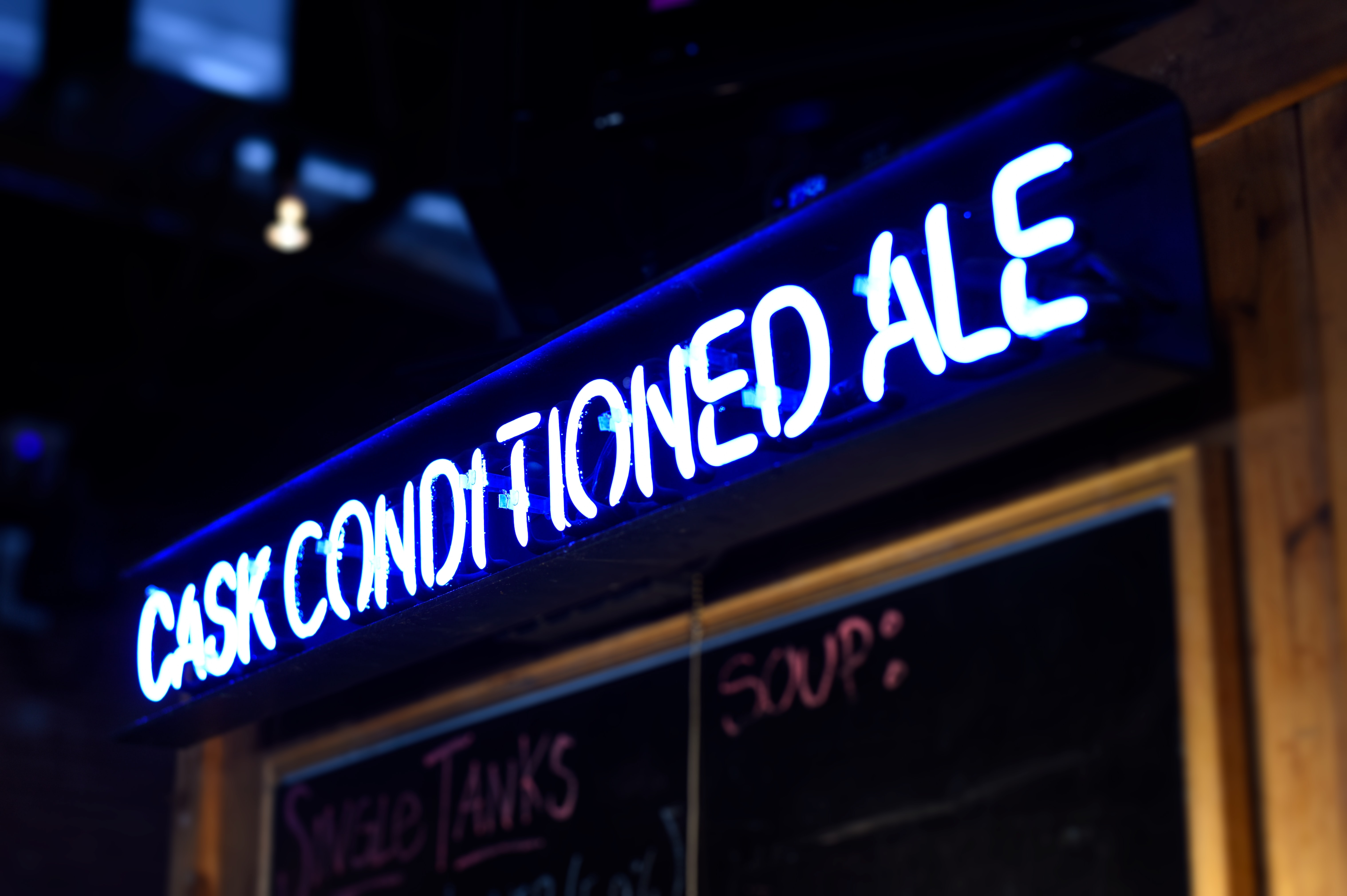 white and blue Cask Conditioned Ale neon signage