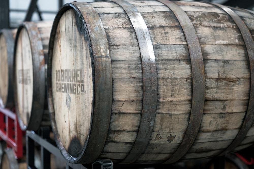beige wooden barrel on black crate