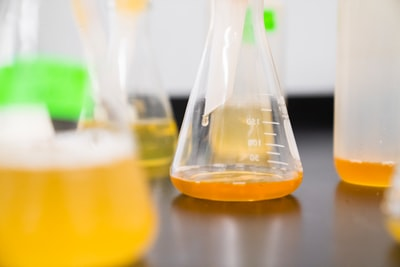 clear erlenmeyer flask on the table chemistry teams background