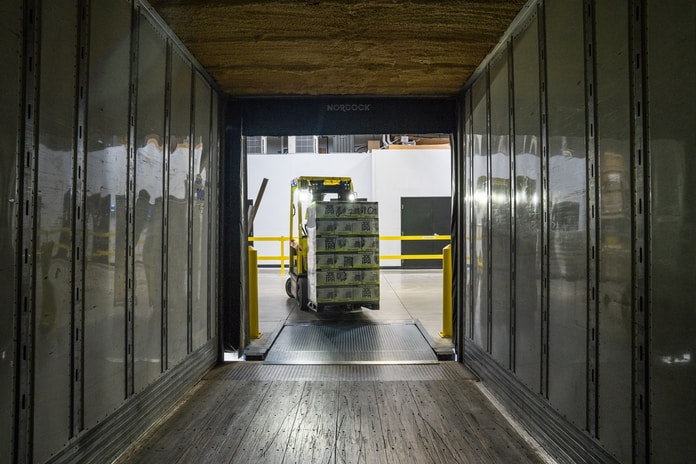 yellow and black forklift during daytime