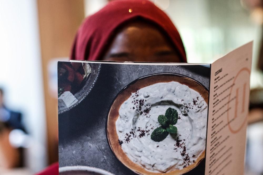 woman reading menu list