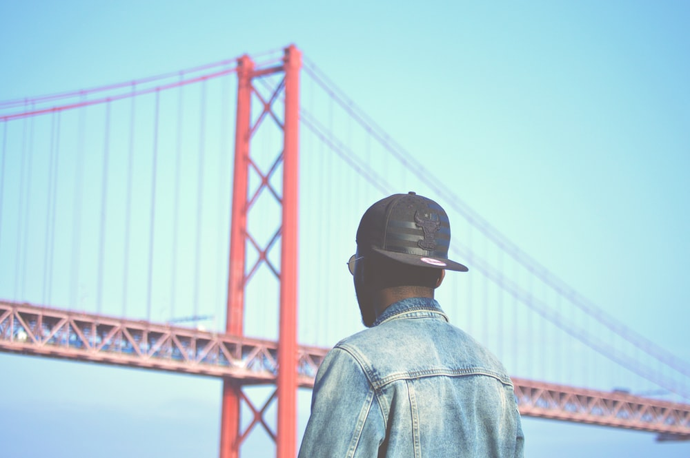 man looking at the Golden Gate Bridge in San Francisco