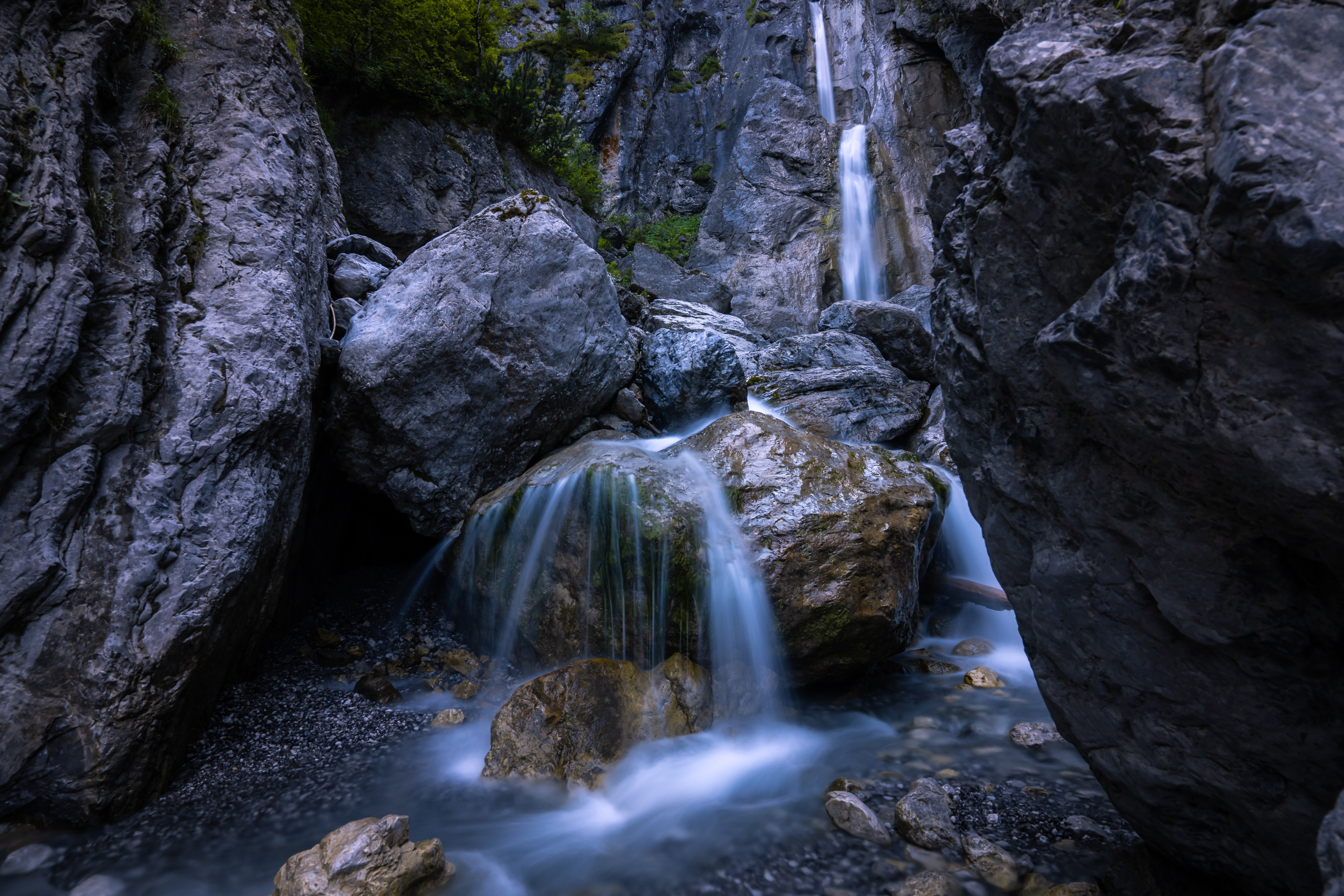 waterfall surrounded by rock formatio n