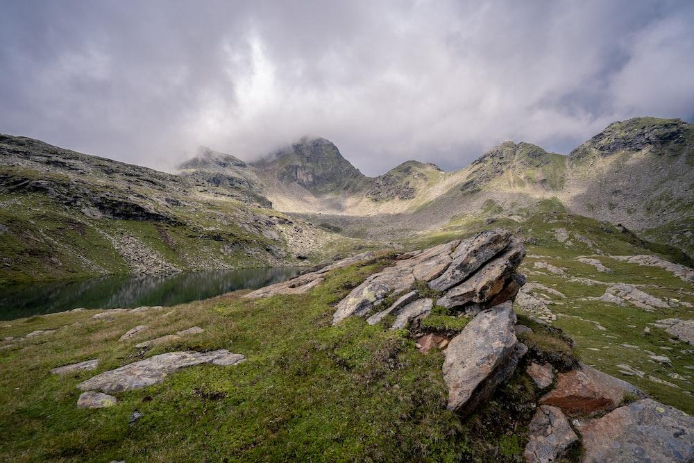 green rocky mountain over horizon
