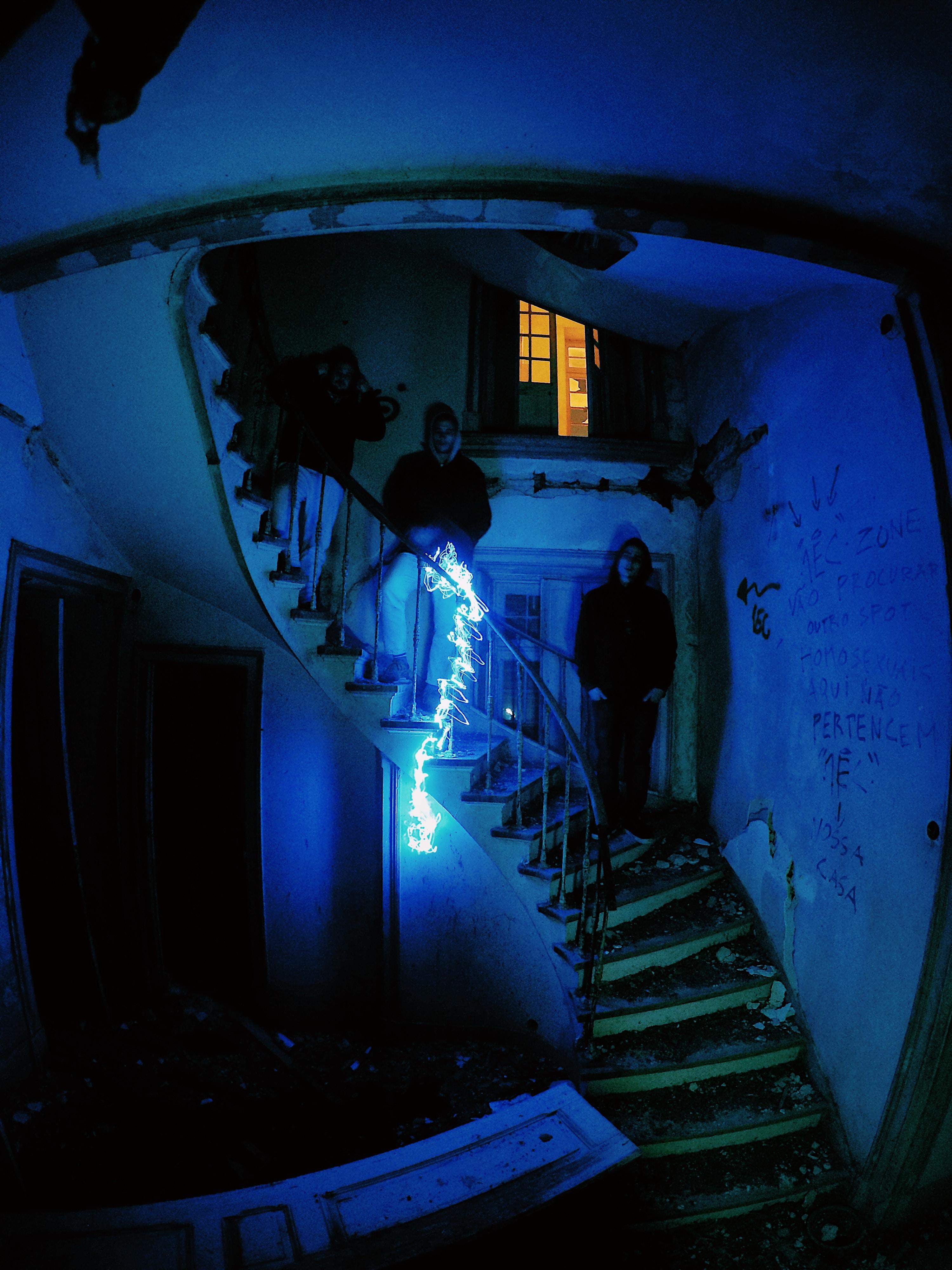 3 men standing on stairway