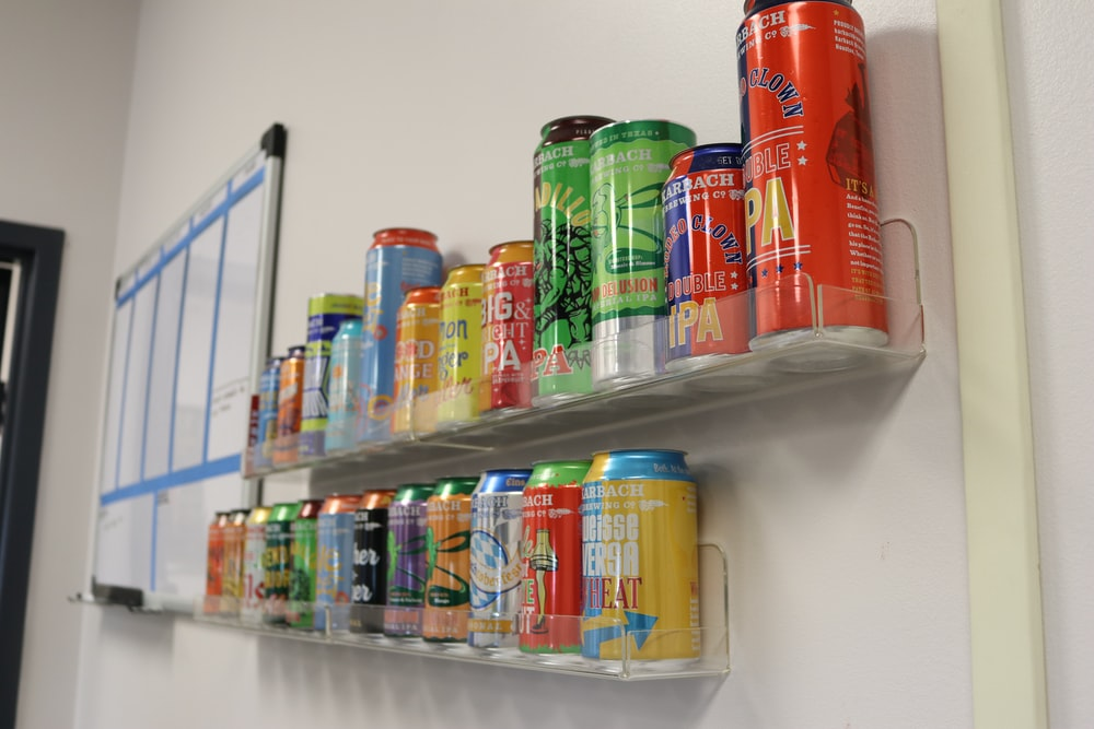 assorted-brand can on rack